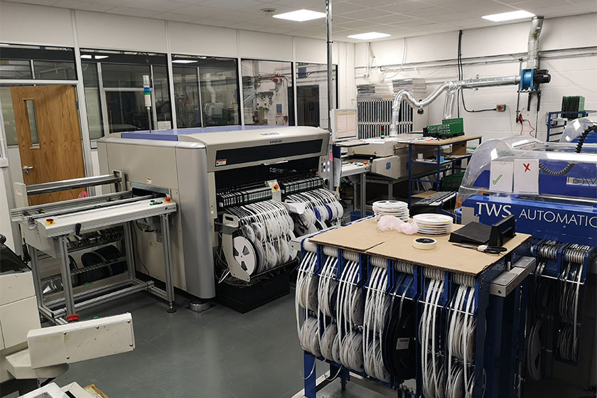 An-automated-surface-mount-assembly-machine-installed-at-PSU-Designs's-state-of-the-art-manufacturing-facility-in-Tipton