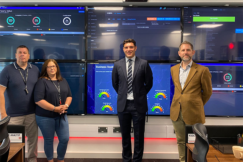 business owners pictured in front of computer screens and fund manager who has supported investment